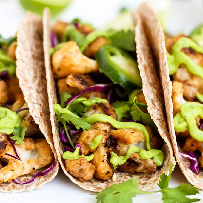 Vegan Buffalo Cauliflower Tacos with Avocado Cilantro Sauce