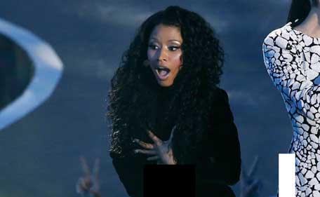 Nicki Minaj Stages Wardrobe Malfunction Dress Rips Apart