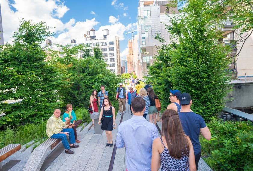 40098277 - new york - circa june 2013: the high line park, new york, circa june 2013. the high line is a popular linear park built on the elevated train tracks above tenth ave in new york city