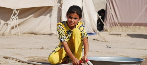A displaced girl at one of the camps reached by Soccer Salam. The camp is one of dozens of encampments near Bzeibiz bridge on the Euphrates River outside Ramadi, Iraq (Photo by IHAO/2015).