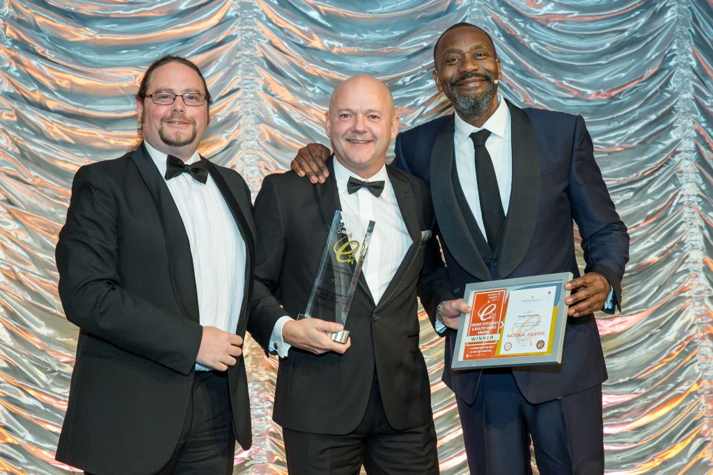 Dominic Griffiths of EPP (left) ready to accept the Award from Sir Lenny Henry
