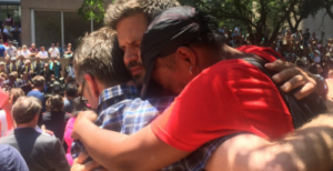 Three strangers hugging
