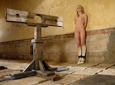 naked female locked in pillory