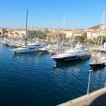 The charming port of Corsica filled with enormous yachts.