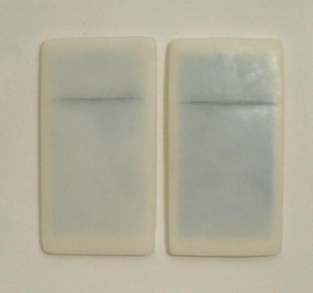 Elena Modorati, Porzioni d'aria, 2012, cera e carta millimetrata, cm 28x32 i due elementi