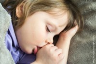 37216522 - sleeping little cute baby sucking thumb