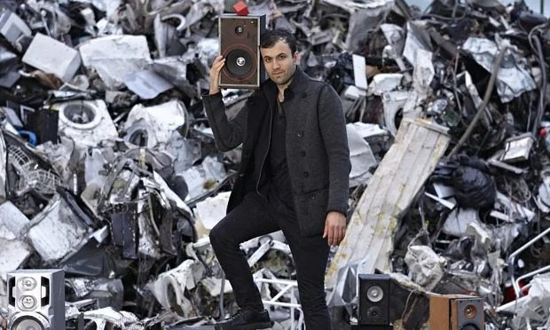 Paul Cocksedge at the Sweeep recycling centre in Kent with his device The Vamp (in red) which can tr
