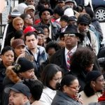 People wait in line for the public viewing of Teddy Pendergrass at the Enon Tabernacle Baptist Church in Philadelphia, Friday, Jan. 22, 2010. (AP Photo/Matt Rourke)