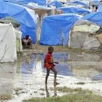 haiti(2010-child-in-puddle-med-wide)