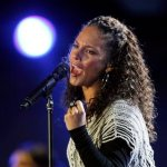 Alicia Keys performs at the opening concert for the soccer World Cup at Orlando stadium in Soweto, South Africa, Thursday, June 10, 2010.