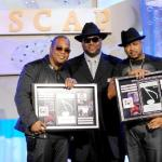 Jimmy Jam (center) presents the Songwriters of the Year Award to Tricky Stewart and The Dream