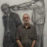 Artist Gil Vicente standing with his vision of assassinating Bush himself.