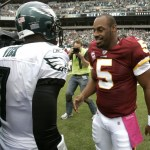 Washington Redskins quarterback Donovan McNabb (R) is greeted by Philadelphia Eagles quarterback Michael Vick before the start of their NFL football game in Philadelphia, Pennsylvania, October 3, 2010. McNabb was traded to Washington during the off-season.