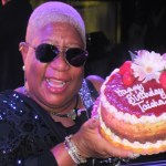 Luenell holds the birthday cake for Ron Artest's sister-in-law