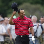Tiger Woods acknowledges spectators after chipping in on the second green during the final round of the Australian Masters golf tournament at the Victoria Golf Club near Melbourne November 14, 2010.