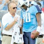 QB Vince Young talks with a member of the Titans training staff