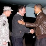 President Barack Obama is greeted by NATO Commander in Afghanistan Gen. David Petraeus, left, and US Ambassador to Afghanistan Karl W. Elkenberry, center, after stepping off Air Force One during an unannounced visit to Bagram Air Base in Afghanistan. Friday, Dec. 3, 2010.
