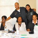 Dr. Whitfield and Nissan Ballard with volunteer members of Earl K. Long Hospital Community Outreach Team