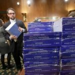 Copies of President Obama&#039;s 2012 budget are delivered to the Senate Budget Committee