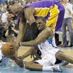Lamar Odom (LA Lakers) and Chris Paul (New Orleans Hornets) fight for ball Sunday night