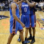 Oklahoma City Thunder guard Thabo Sefolosha, of Switzerland, left, guard Russell Westbrook (0) and James Harden, right, celebrate after beating the Memphis Grizzlies in Game 4 of their second-round NBA basketball playoff series