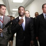 Michael Vick of the Philadelphia Eagles leaves Capitol Hill after speaking on behalf of the Humane Society in support of legislation that will crack down on animal fighting spectators during a news conference in Washington July 19, 2011.
