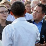 Ryan Rhodes, right, and another member of the Iowa Tea Party Revolution, speak to President Barack Obama at a town hall meeting, Monday, Aug. 15, 2011, at the Seed Savers Exchange in Decorah, Iowa, during his three-day economic bus tour.
