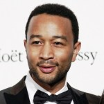 John Legend attends the third annual amfAR Milano event, held in conjunction with Milan Fashion Week at La Permanente in Milan.