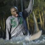 Malik (Sinqua Walls) is terrorized by a shark in 'Shark Night 3D'