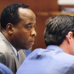 Dr. Conrad Murray (L) listens to a testimony as he sits with his attorney Ed Chernoff during his trial in the death of pop star Michael Jackson in Los Angeles Oct. 11, 2011.