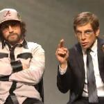 Jason Sudeikis and Ben Stiller as Hank Williams Jr. and his spokesman asking for an apology from Fox and Friends