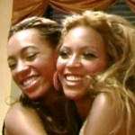"Beyonce and her sister Solange in a scene from her video for ""I Was Here"""