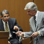 Defense Attorney J. Michael Flanagan and defense witness Dr. Paul White (L) look at evidence during a redirect examination at the final stage of Conrad Murray&#039;s defense during his involuntary manslaughter trial in the death of singer Michael Jackson at the Los Angeles Superior Court in California October 31, 2011.