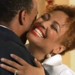 "Kim Fields hugs hubby Christopher in her TV One special ""Holiday Love"""