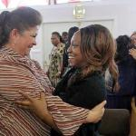 women embrace in church