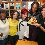 "The Talk: (L/R) Sheryl Underwood, Sara Gilbert, Sharon Osbourne, Aisha Tyler and Julie Chen, hit New York City's famous Carnegie Deli to pose with the new sandwich named after them: ""The TALKwich."" (Dec. 12, 2011)"