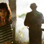 Alexandra Daddario and Dan Yeager (Leatherface) in a scene from the Lionsgatre presentation of Texas Chainsaw 3D.
