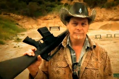 ted nugent (automatic rifle on shoulder)