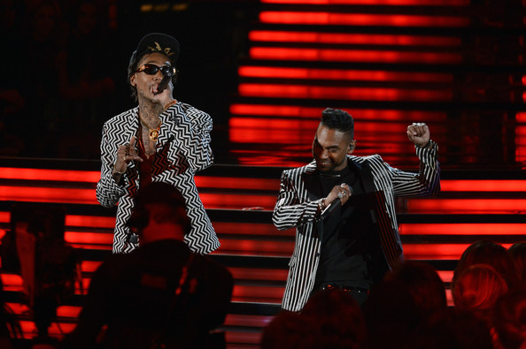 Rapper Wiz Khalifa (L) and singer Miguel perform onstage at the 55th Annual GRAMMY Awards at Staples Center on February 10, 2013 in Los Angeles