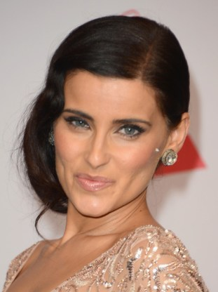 Singer/songwriter Nelly Furtado poses in the press room during the 13th annual Latin GRAMMY Awards held at the Mandalay Bay Events Center on November 15, 2012 in Las Vegas