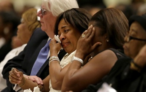 Chris Kelly's mother Donna Kelly Pratt wipes a tear