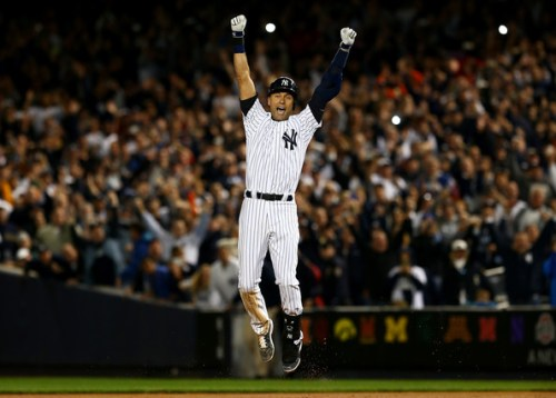 Derek Jeter #2 of the New York Yankees celebrates after a game winning RBI hit in the ninth inning against the Baltimore Orioles in his last game ever at Yankee Stadium on September 25, 2014 in the Bronx borough of New York City.