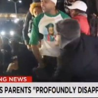 Video Captures Michael Brown's Stepdad Yelling 'Burn This B**ch Down' (Watch)