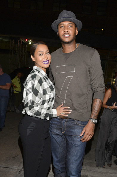 DJ La la Anthony and basketball player Carmelo Anthony arrive at the rag & bone fashion show during Mercedes-Benz Fashion Week Spring 2015 at Skylight at Moynihan Station on September 8, 2014 in New York City