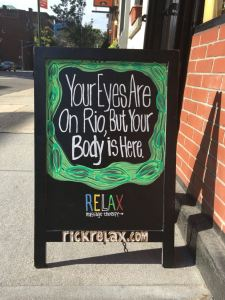 Relax - Your Eyes Are On Rio, But Your Body is Here. Relax Massage Therapy - Storefront sign - by Evan Silberman Ads