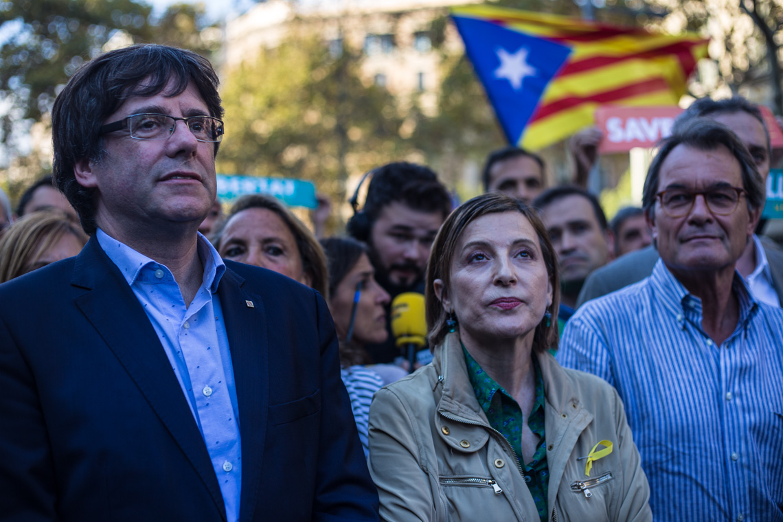 The Catalan President Carles Puigdemont with Carmen Forcadell, the president of the Parliament, and Artur Mas, the ex-President of Catalonia who promoted the independence movement in Catalonia, on the day that the Spanish Government has announced to apply the 155 article to dissolve temporarily the Catalan Government until there will be announced new elections. The 25th of October there have been a big demonstration to claim the freedom of the main leaders of the catalan separatist movement, Jordi Cuxart and Jordi Sanchez. Photo: Eva Parey