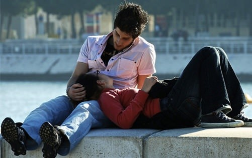 Romantic  Couple Sitting Together