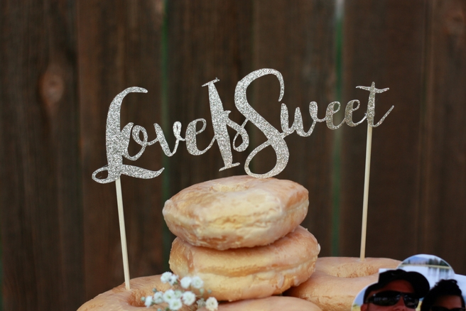 Donut wedding cake. Pictures and cake topper made using a Cricut machine.