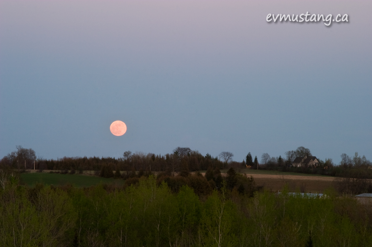 image of the largest full moon of the year rising over the countryside