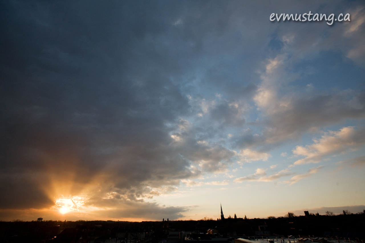 image of snow clouds over downtown peterborough at sunset